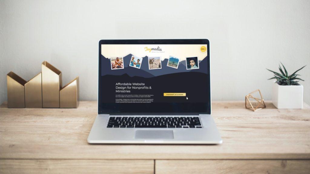 Laptop computer browsing Joy Media's website